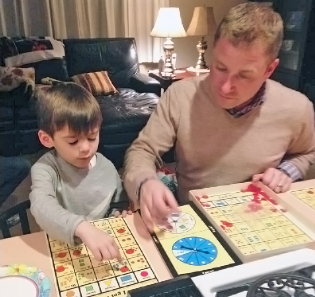 Dad and Son Playing a Favorite Board Game - I Got It!